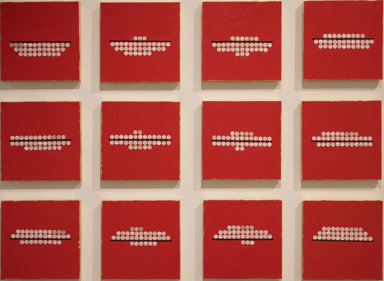 under/over by Ann Chisholm. Paper and acrylic paint on canvas.  42x58x1 in under/over is about inequality.   This work consists of 12 pieces that are each 12 x 12 x 1 inches. With a red background, and gold foil edges, there are 33 circles on each