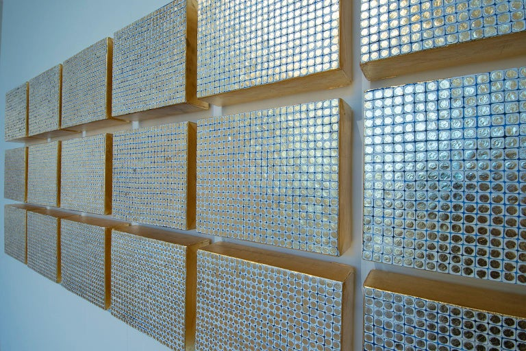 Karat relates to America's obsession with money. The thick gold leafed canvases are like gold bricks. There are 18 canvases in this piece which represent the idea of always wanting more and the longing for 24. Karat also uses the reoccurring motif