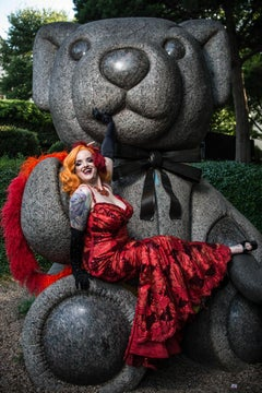 Vivienne by Can Turkyilmaz. Bright red dress posing on a teddy bear sculpture