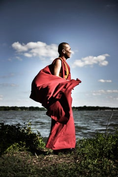 Precious by Can Turkyilmaz. Photograph Monk in red by lake