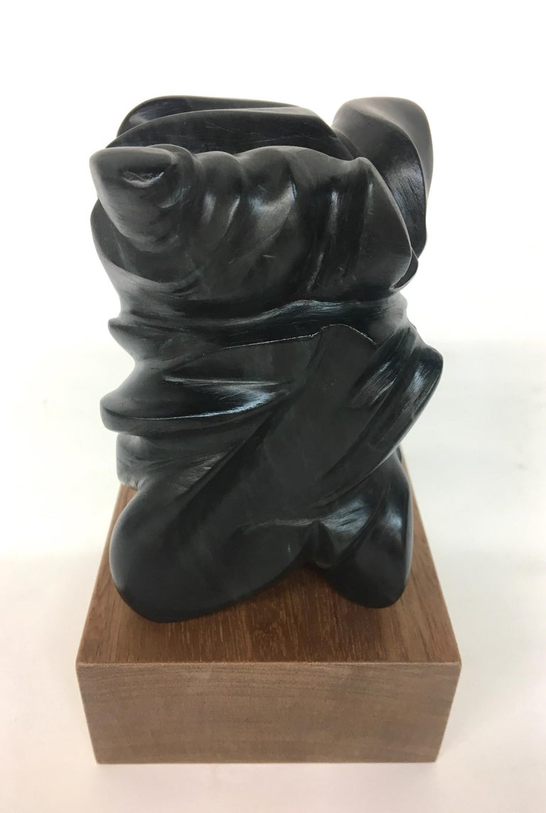 """MULTIPLICITY"" sculpture by Melanie Newcombe Hand carved soapstone with wooden base The soapstone is reversible  4.5"" x 3"" x 3"" inch 2018  * * * Melanie Newcombe * * * * * Artist Statement * * I am perpetually pushing materials toward innovative"