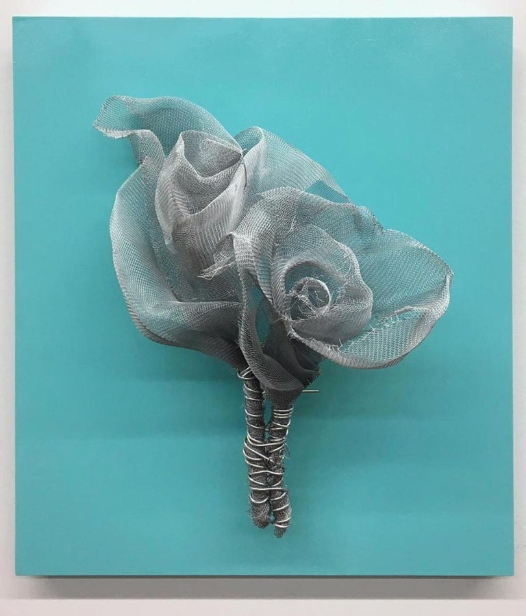 """ROSES DELICIOUS sculpture by Melanie Newcombe Aluminum window screen, aluminum wire, wood, paint  19"""" x 17"""" x 7"""" inch 2018  * * * Melanie Newcombe * * * * * Artist Statement * * I am perpetually pushing materials toward innovative structures, with"""