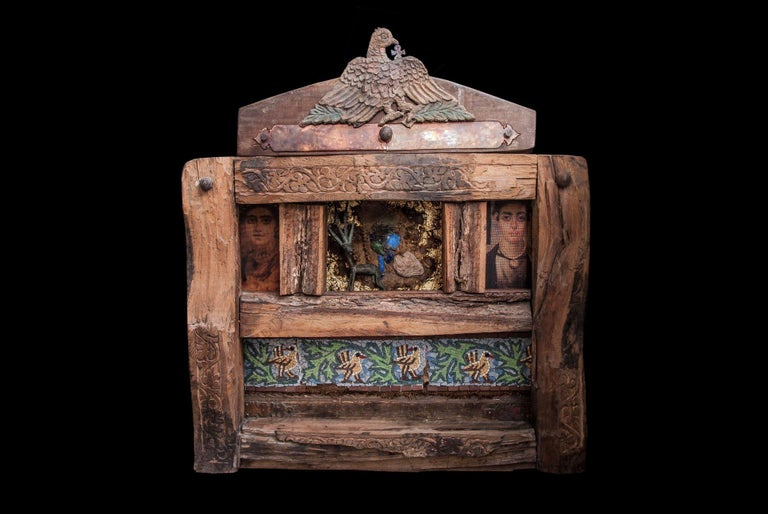 """""""Alexandrian Icon"""" Mixed media Wooden work 33""""x30""""in. by Alfons Louis  Wooden work with elements of Bronze, Glass, and Iron.   ABOUT THE ARTIST Born in Cairo 1959- Graduated from faculty of fine art (painting) Alexandria. In 1982 – Member of plastic"""