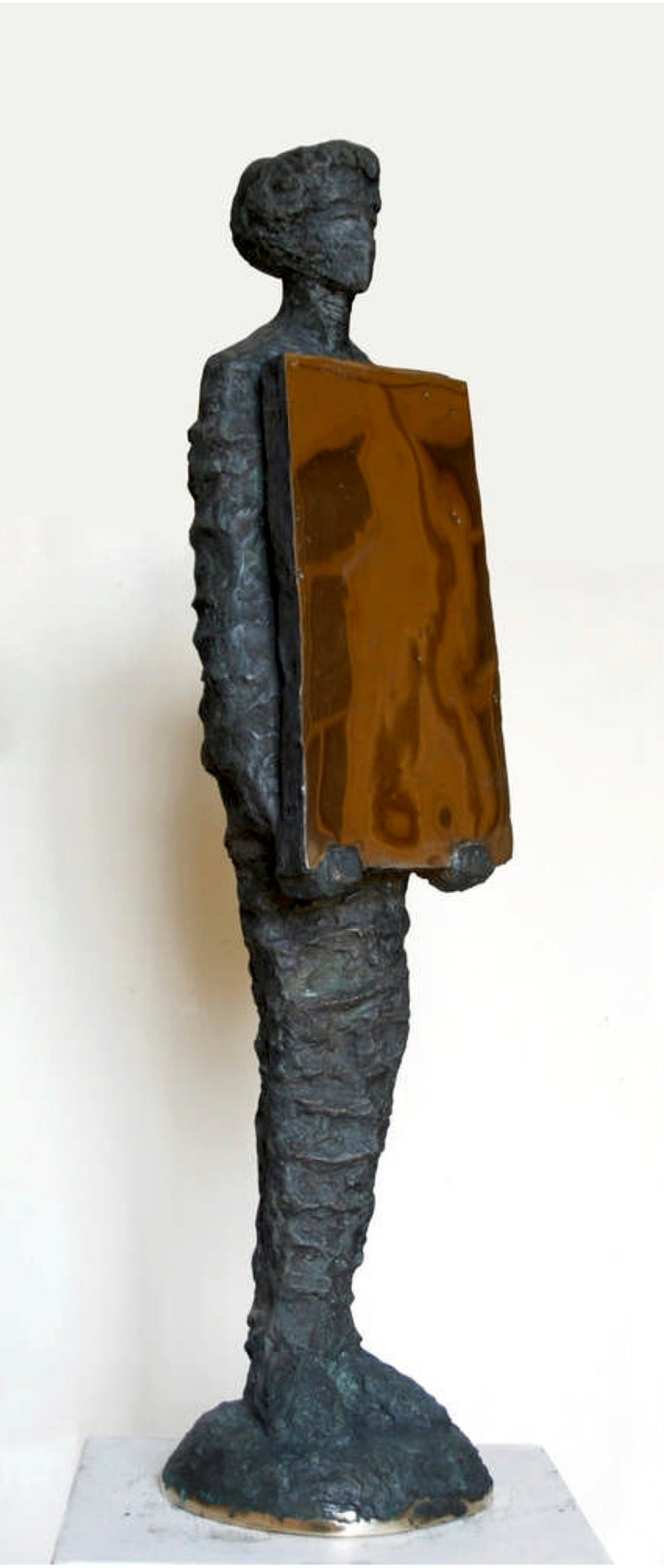 """Holding Mirror"" Bronze Sculpture 38""x8""x7"" inch by Sarkis Tossonian			   Sarkis Tossoonian was born in Alexandria in 1953. He graduated from the Faculty of Fine Arts/Sculpture in 1979. He started exhibiting in individual and group exhibitions in"