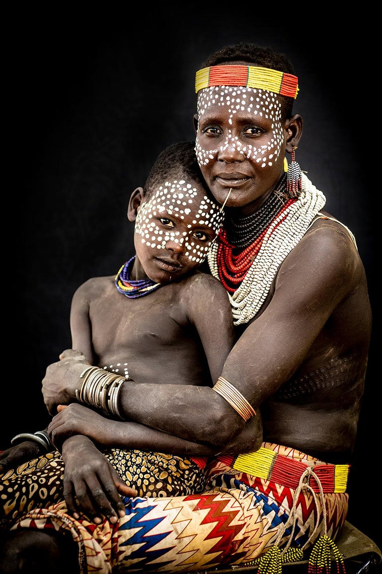 """""""Karo Mother and Son"""" Photography 40"""" x 26.5"""" inch Edition 2/7 by Safaa Kagan  Omo Valley, Ethiopia series 2018   ABOUT   Safaa is a Los Angeles based photographer with a mission to dissolve the surface-level barriers presented in humanity. Born in"""