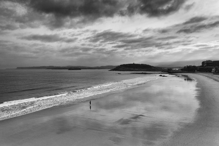 Frédéric Ducos Black and White Photograph - Alone on the beach in Santander