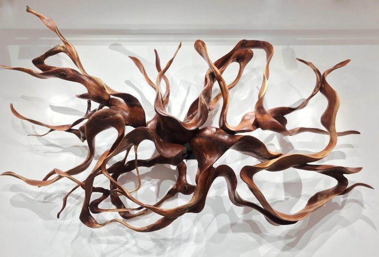 Mahogany wood sculpture, made out of roots.