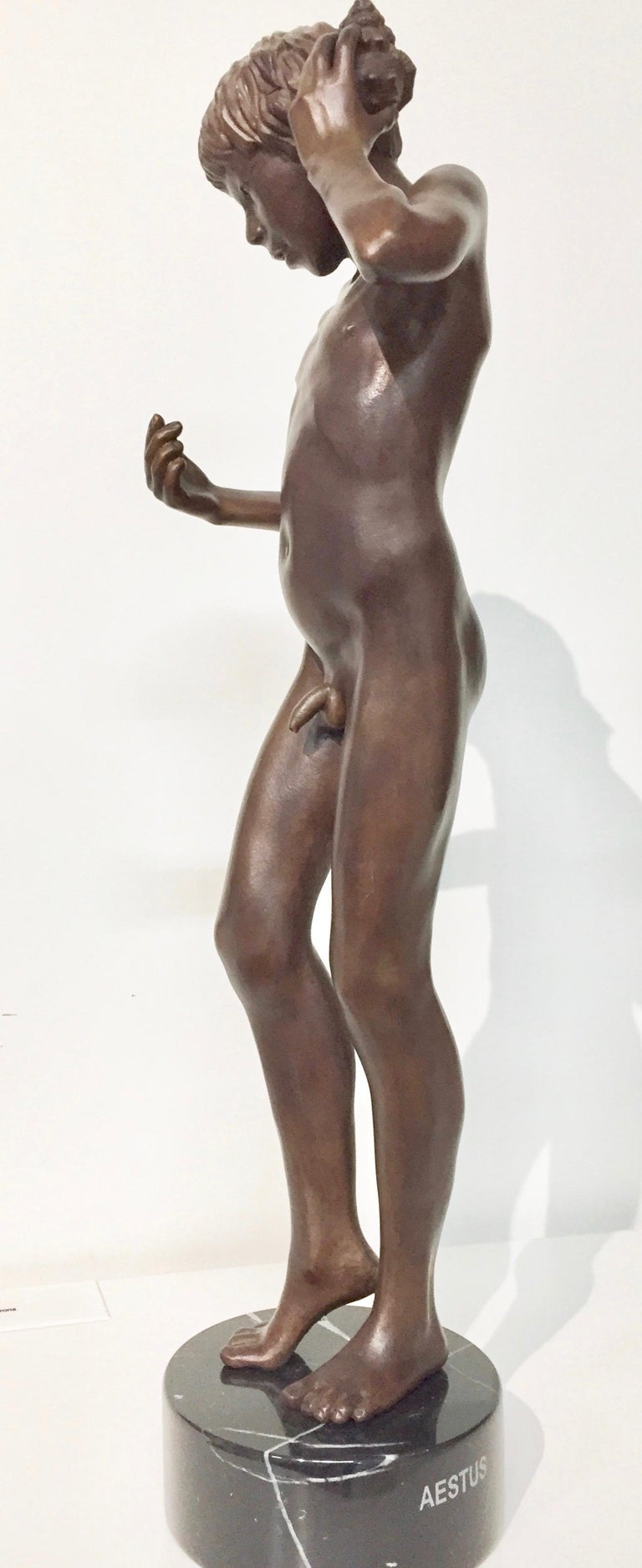 Wim van der Kant Nude Sculpture - Aestus- 21st Century Bronze Sculpture of a Young Nude Boy with a Shell