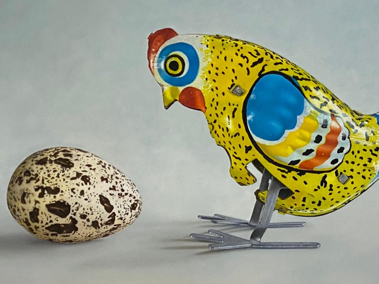 Huh? - 21st Century Dutch  Still-life painting of a Tin Toy Chicken and an egg - Painting by JP Marsman
