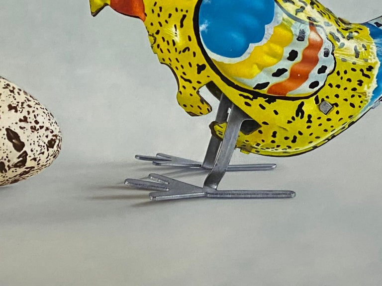 Huh? - 21st Century Dutch  Still-life painting of a Tin Toy Chicken and an egg - Contemporary Painting by JP Marsman