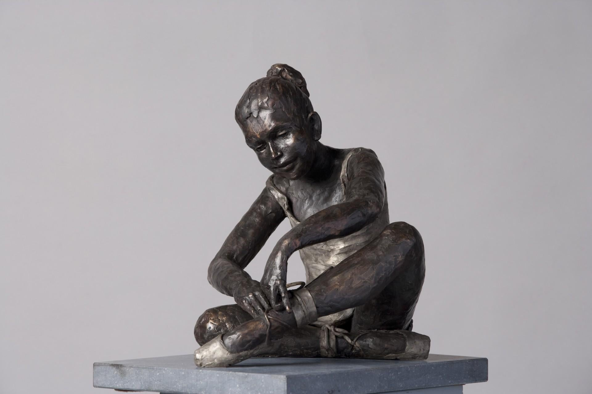 Vasily- 21st Century Sculpture of a ballet dancer sitting and tidying her shoe