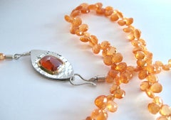 Mandarin Orange garnet necklace & Spessartite Garnet cabochon clasp by Susan Kun