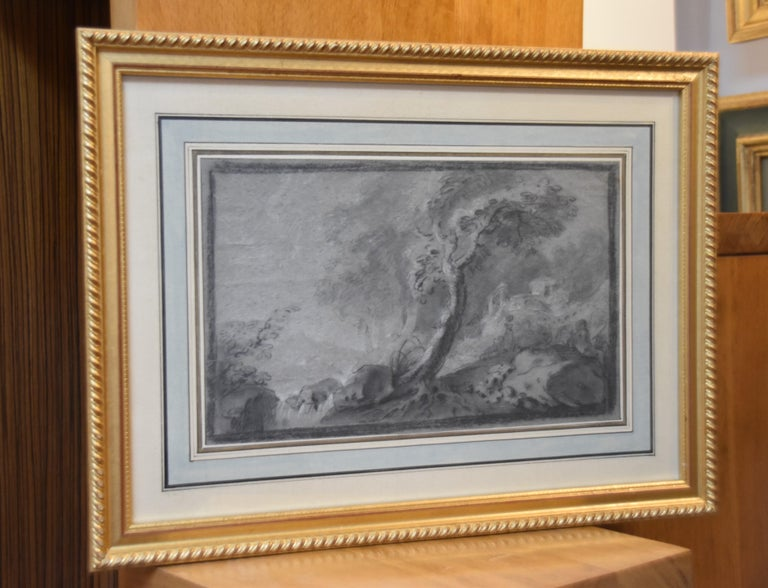 France 18th Century,  Imaginary Lanscape Black chalk and heightenings of white gouache on blue-grey paper 19 x 31 cm Framed : 34.5 x 46.5 cm  The atmosphere and the subject have suggested this drawing had been designed in the close circle of Jean