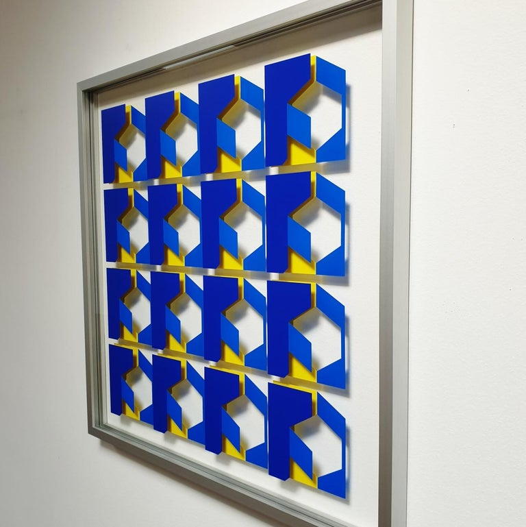 Relief MG902 is a medium size contemporary modern abstract geometric wall relief by Dutch visual artist Let de Kok. This relief consists of two interspaced panels of museum glass with a multi-layer geometric pattern cut from uv-resistant polymeric