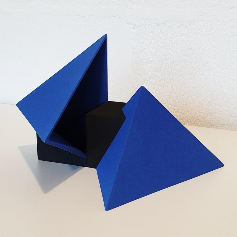 Sculpture SC1502 (blue) is a contemporary modern abstract geometric object sculpture by Dutch visual artist Let de Kok.  This sculpture consists of two ceramic elements and both the blue and the black surfaces are textured and rough caused by the