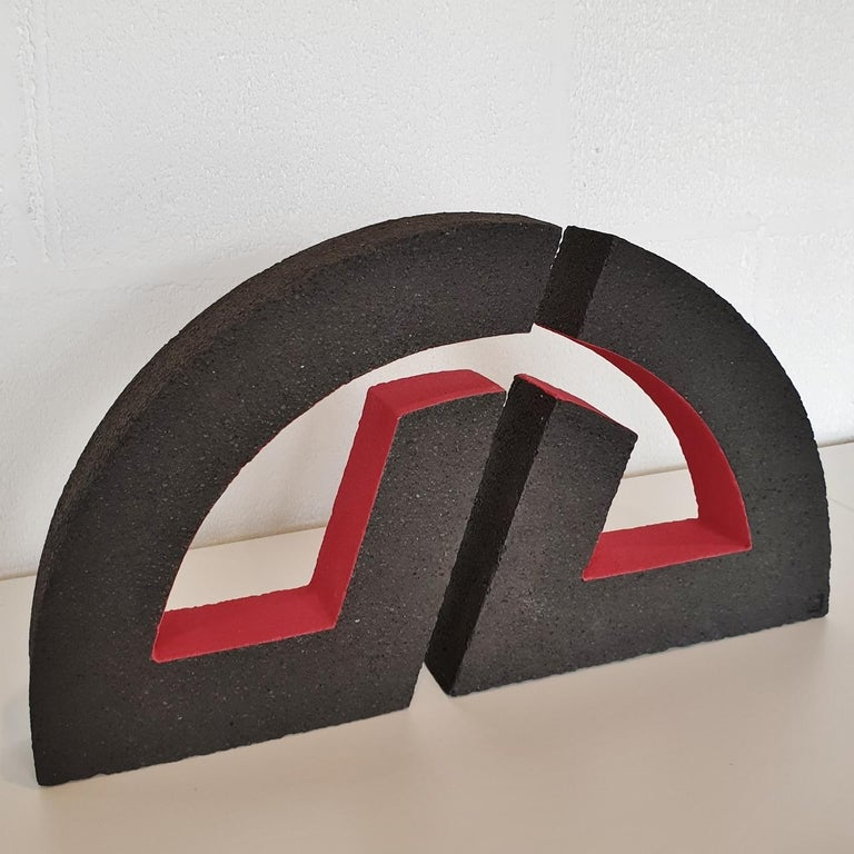 This work is a unique contemporary modern abstract geometric sculpture object by Dutch visual artist Let de Kok. This sculpture is made of dark grey chamotte clay slabs carefully put together to create two curved geometric bodies. After drying and