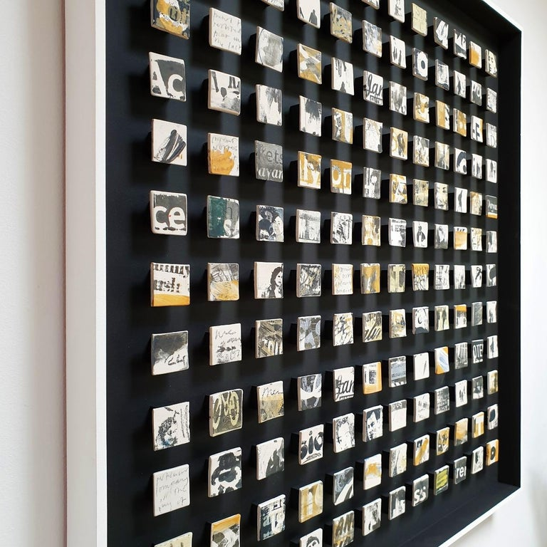 Sunset memory is a unique contemporary modern wall object by British artist Kate Brett. This one of a kind object consists of  144 handmade unglazed porcelain elements mounted in a hand painted matt black frame with a white raised edge. At the rear