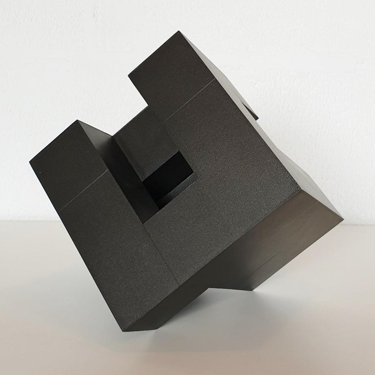 Cube architectural I is the first of two free standing contemporary modern abstract wall sculptures from the Architectural-series by French-Dutch artist Olivier Julia. This sculpture is made from carefully cut, glued and sanded wood fiberboard