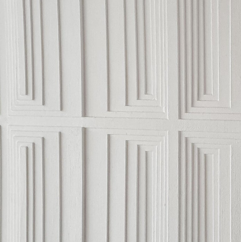 Vertical Process 2A is a unique one-of-a-kind contemporary modern painting relief by Dutch artist Eef de Graaf. The relief is made from meticulously hand cut cardboard elements finished with a matt white acrylic paint. This art work is mounted in a