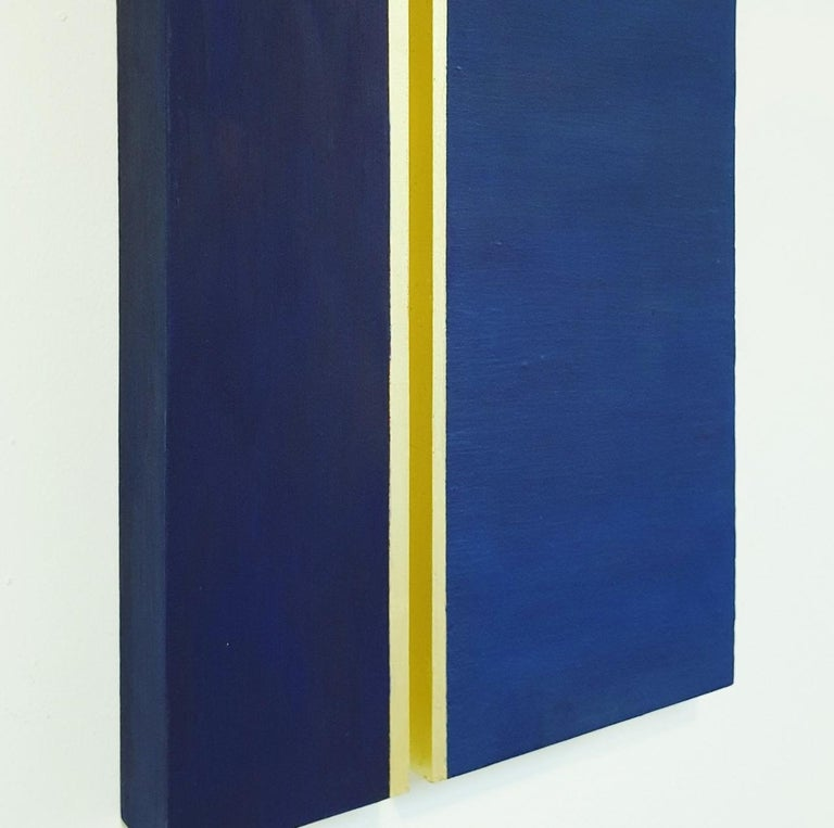 Rayon lumineux is a unique medium size contemporary modern sculpture painting relief by French-Dutch artist Olivier Julia. The relief is made from two blue-painted textured wood panels with gold leaf and is part of his explorations of panel type