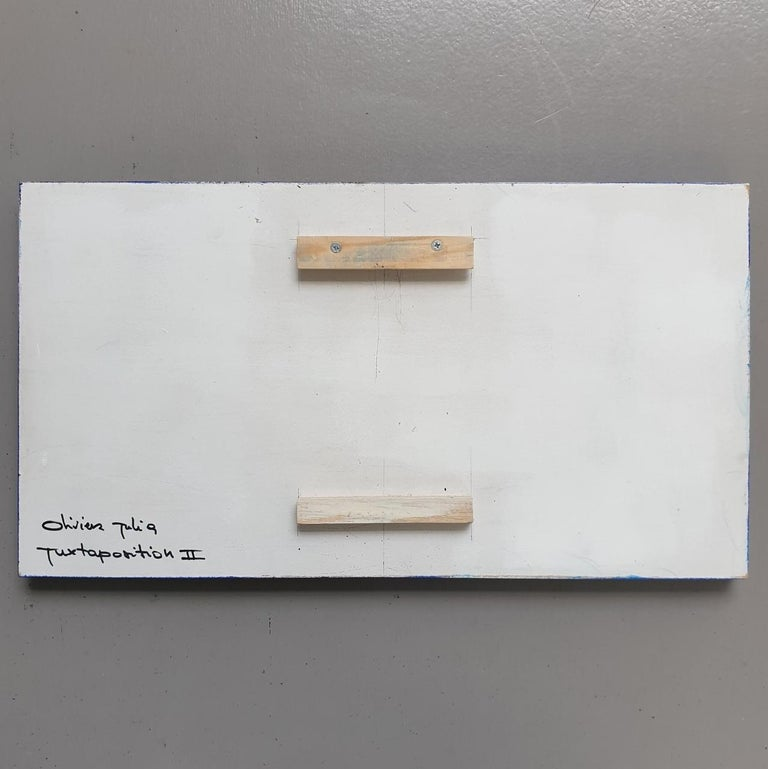 Juxtaposition II is a unique small size modern sculpture painting panel by French-Dutch artist Olivier Julia. The panel hangs slightly free from the back wall, creating a floating visual experience and is another example of his explorations of panel