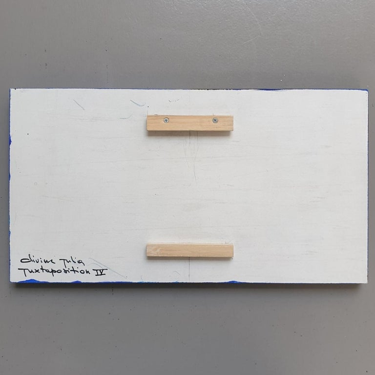 Juxtaposition IV is a unique small size modern sculpture painting panel by French-Dutch artist Olivier Julia. The panel hangs slightly free from the back wall, creating a floating visual experience and is another example of his explorations of panel