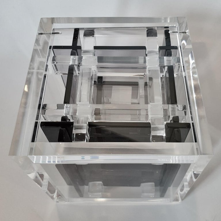 Homage to Bach is a unique small size contemporary modern cube sculpture by the famous Dutch artist couple Nel Haringa and Fred Olijve. The cube sculpture consists of a few dozen hand cut hand polished grey and clear transparent plexiglass elements