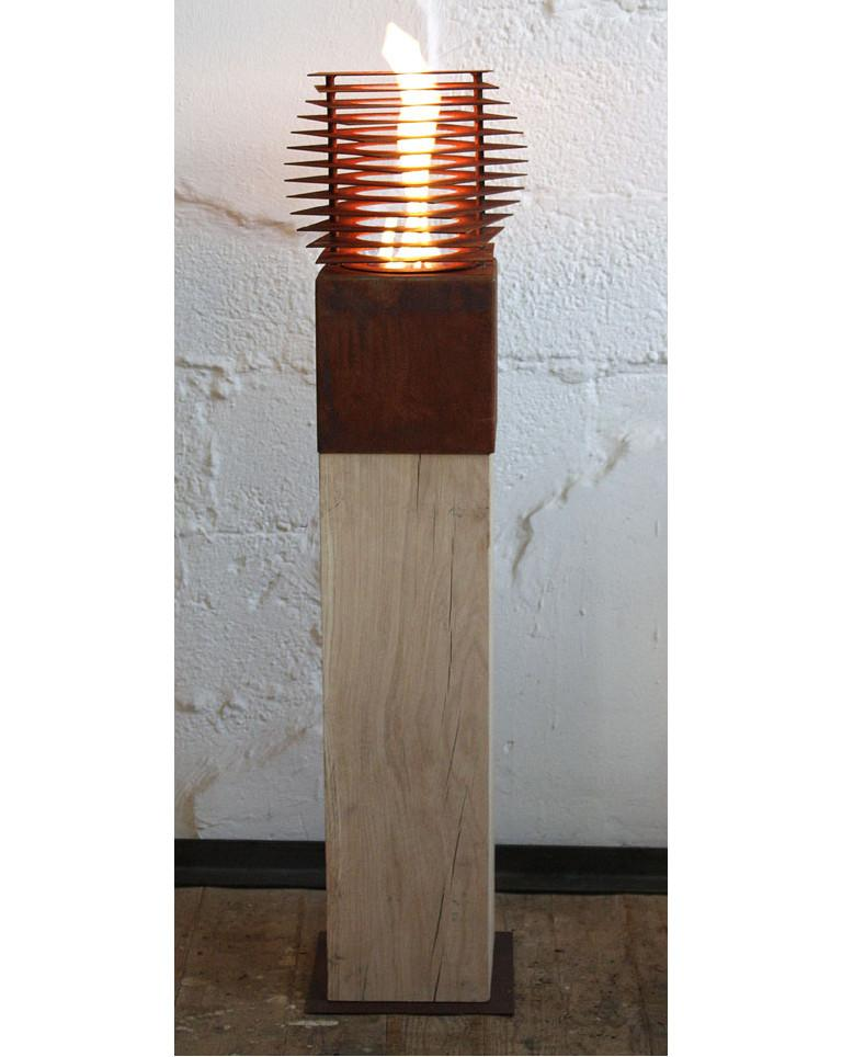 Extraordinary garden torch with one burner insert on an untreated oak spot. If the spot is set up outside, she develops a gray patina.  The included burner already contains individual lava stones, so this burner can easily be filled with liquid