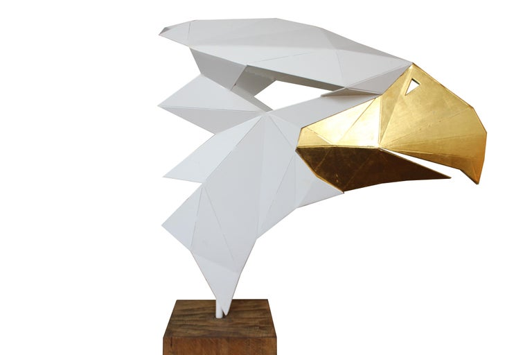 Beak is 24 karat gold leaf. Body is white pulver powder coated. This unique art piece is handmade, so expect a delivery around 6 weeks.  Very high quality thick plated stainless steel: 3-4 mm (usually max 2 mm).  Eagle: 55 x 30 x 55 cm Total Height: