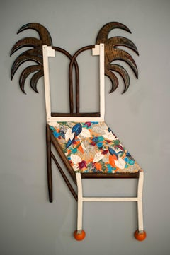 Essence of Chippendale, ornate chair with colorful plant and floral patterns
