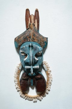 Deacon, tribal mask wall sculpture, painted wood, mixed media