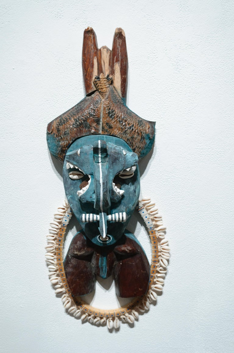 Margaret Wharton Still-Life Sculpture - Deacon, tribal mask wall sculpture, painted wood, mixed media