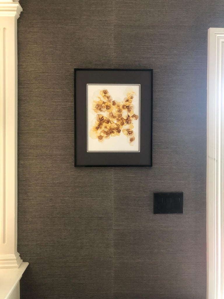 Interior design paintings. The work was done with alcohol ink in yellow, vanilla, brown, caramel color on Yupo paper. The work is 11 by 14 inches in size, framed without glass on a double mat board in dark brown with sizes 16 by 20 in.   It is also