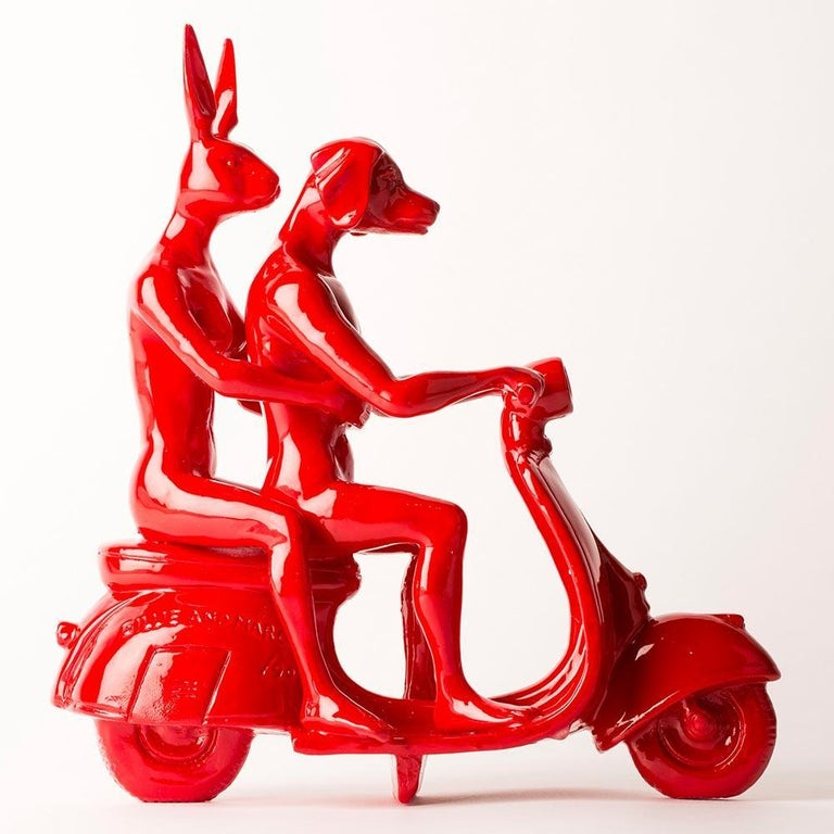 Title: The Vespa Lovers (Red) Authentic resin sculpture Open Edition  This stunning miniature sculpture is modelled off one of Gillie and Marc's most iconic pieces of work, featuring Dogman and Rabbitwoman riding a Vespa. When Gillie and Marc first