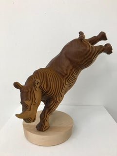 Ballerhino..Contemporary whimsical animal sculpture, wood slices, dancing rhino
