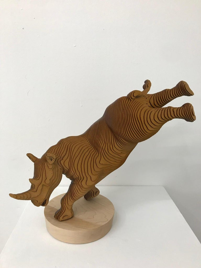 Ballerhino..Contemporary whimsical animal sculpture, wood slices, dancing rhino - Sculpture by Olivier Duhamel