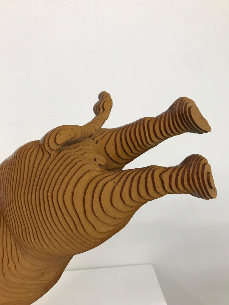 Ballerhino..Contemporary whimsical animal sculpture, wood slices, dancing rhino - Brown Still-Life Sculpture by Olivier Duhamel