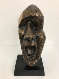 The Impact of reflection : contemporary man face bronze sculpture golden patina
