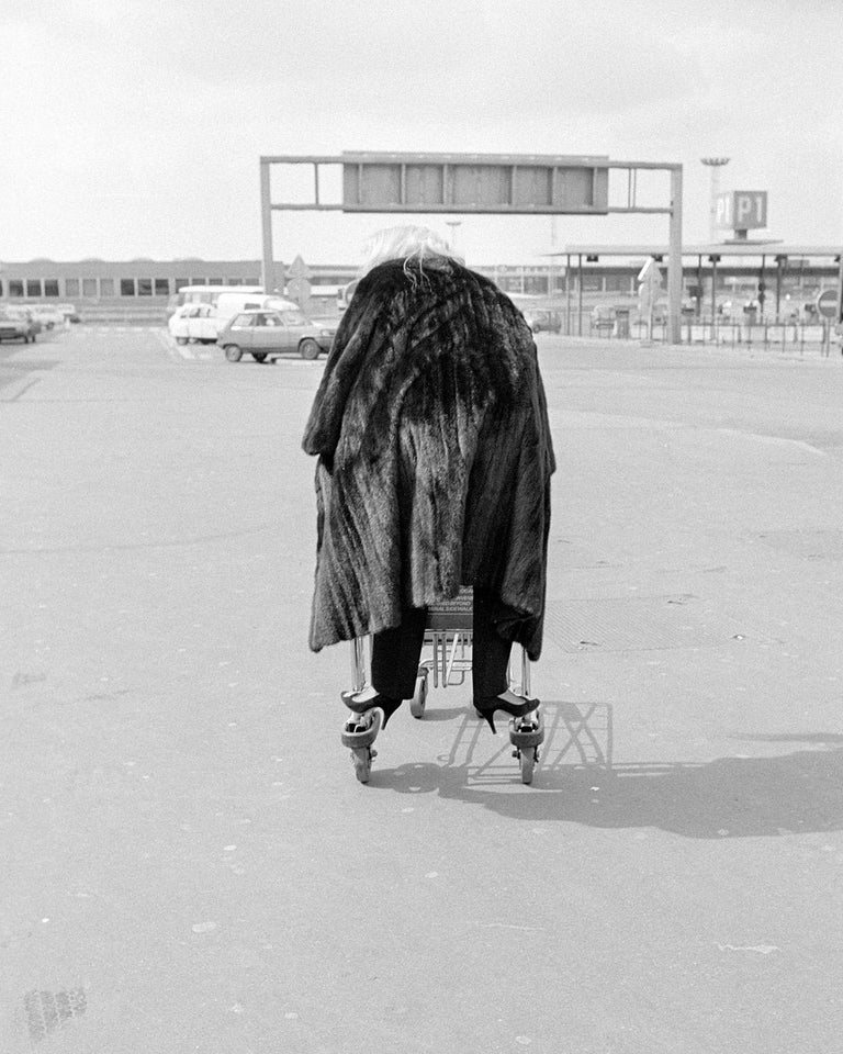 Richard Young Black and White Photograph - Fur Coat on the Run, Tunisia, 1983, Photography