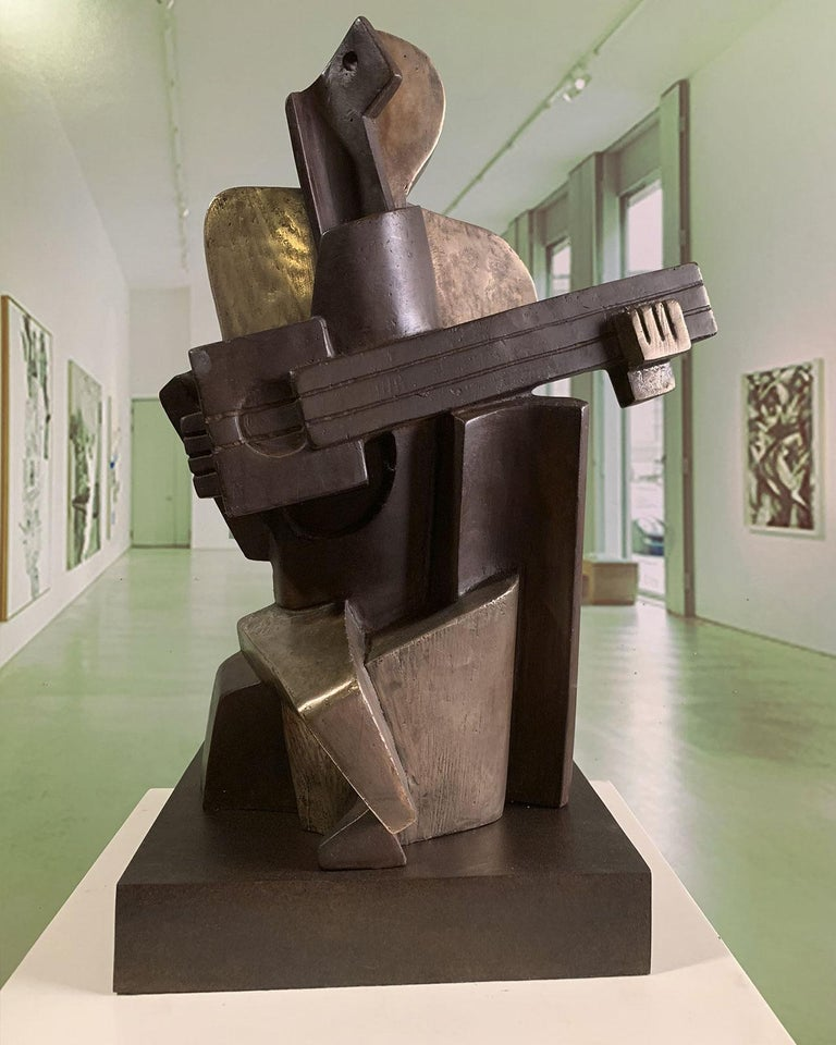 """Cubist Sculpture """"Big Guitarist Arlequin Casting Bronze"""" by Miguel Guía. This sculpture is made by lost wax bronze casting. Limited edition of 30 works. Although the required time to deliver a shipment is usually between 3 and 10 days please do not"""