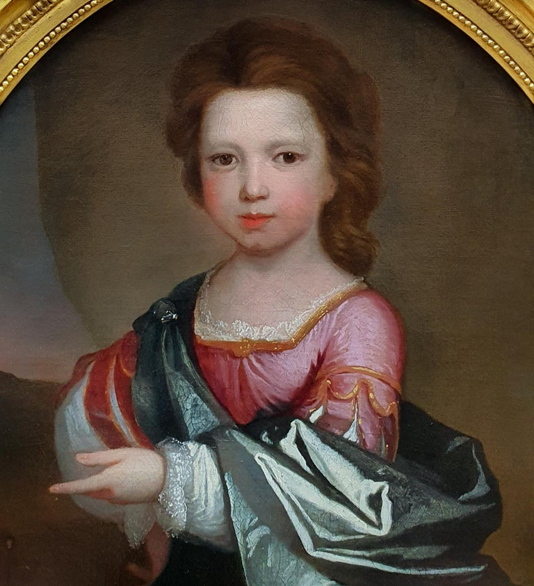 Portrait of a young girl in Roman costume c.1695, Antique Oil Painting Attributed to Edward Byng (c.1676-1753)  This charming portrait depicts a young girl dressed in