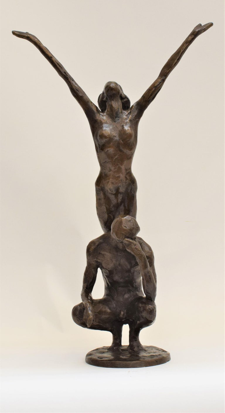 Bronze statue of sitting man and woman balancing on the back - Kees Verkade  - Sculpture by Kees Verkade