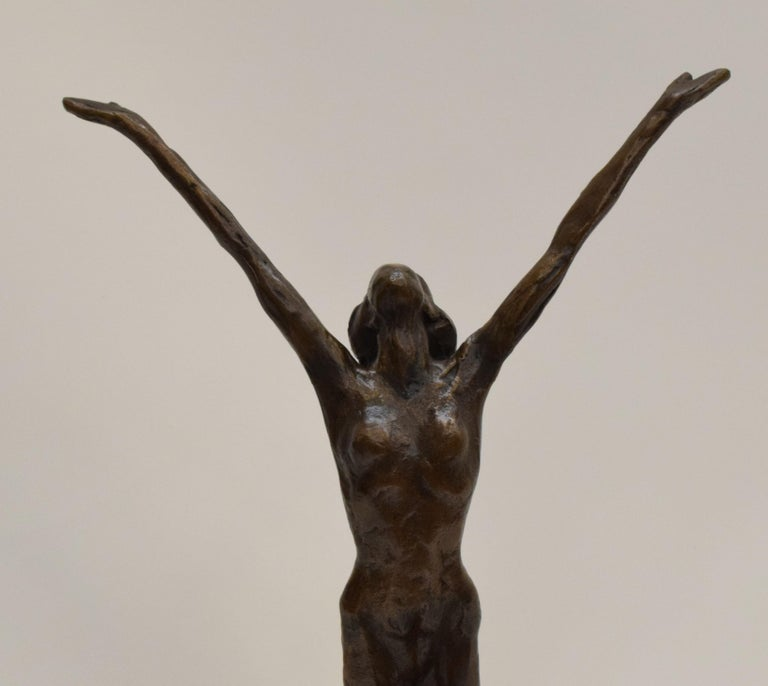 Bronze statue of sitting man and woman balancing on the back - Kees Verkade  - Realist Sculpture by Kees Verkade