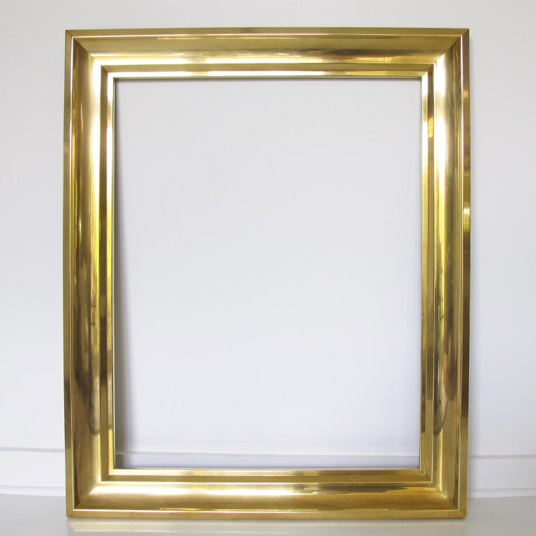 Lovely 1940s French polished brass frame. Perfect for painting, drawing, lithograph, mirror or inventive decoration. Large shape that can be placed in portrait or landscape position. Polished gilded brass with deep carving all around.  Measurements: