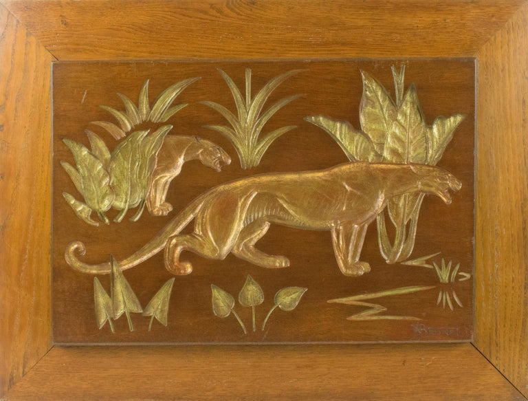 A sumptuous engraved wooden panel depicting panthers in the bush by N.R. Brunet (France, 20th Century). Art Deco design typical of the period, N.R. Brunet is known for his bronze sculptures representing felines. The engraving works done on a wooden
