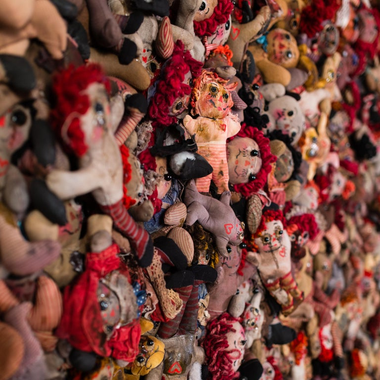 Media: Hand sewn and aged dolls: Fabric and thread with mixed media on wood panel.  Marsian De Lellis is an interdisciplinary artist and writer who constructs installations and time-based visual narratives that memorialize obsessional lives. They