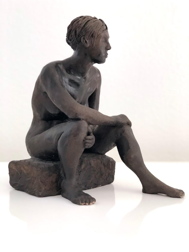 Female sculpture by San Diego California artist Doug Crozier. Glazed terracotta, which mimics natural brown patina of bronze or brass.  Douglas Crozier worked as art director for various companies, enjoys the beach and being part of an original rock