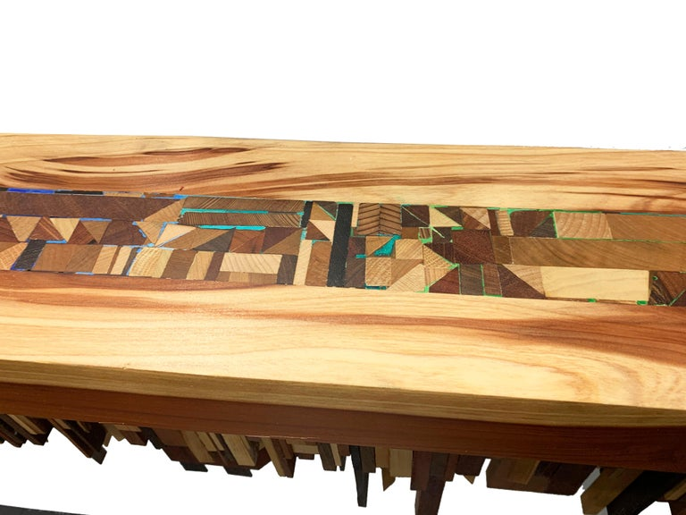 Artful one-of-a-kind long shelf or sculpture by artist Ben Darby. Made of various pieces of wood and accented with multi-color acrylic paint. We selected this piece soon after it was completed and as with many of Darby's artwork, this piece is a