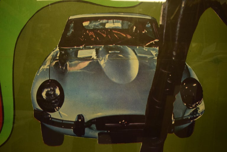 Original cinema mod art poster for this now iconic Italian caper film starring John Phillip Law in front of his femme fatale's white Jaguar XK-E now in a custom Ferrari red chrome frame.
