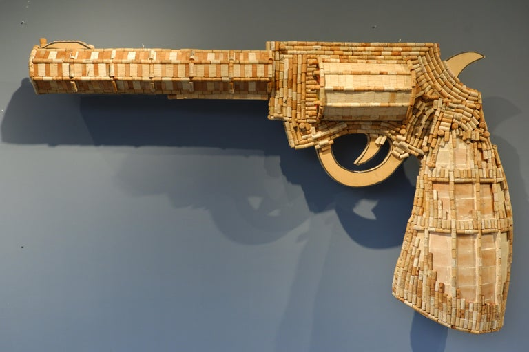 Guns Pop; wood based, made out of approx. 2400 recycled Wine and Champaign corks, It's unique.  Obsessed with wine corks, consumer culture, and mechanical, Costa Rican commercial artist Audie created some of the most iconic natural sculptures. As